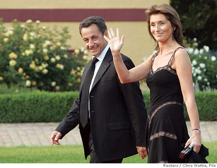 France's President Nicolas Sarkozy (L) and his wife Cecilia arrive for an official dinner in Hohen Luckow in this June 6, 2007 file photo. Sarkozy and his wife Cecilia are separating by mutual agreement, the president's office said in a statement on October 18, 2007. The announcement ends weeks of speculation about the state of the Sarkozy marriage and follows media reports that the pair secretly saw a judge on Monday to file for divorce. REUTERS/Chris Wattie/Files (GERMANY) Photo: CHRIS WATTIE