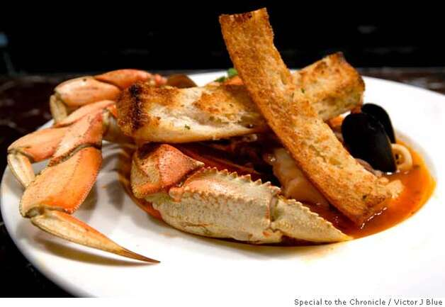 A dish called Cioppino is readied at Bistro Boudin on Fishermans Wharf in San Francisco, CA Thursday May 11 2006. Cioppino is a mix of craab, shrimp, mussels and calamari. Victor J Blue/The Chronicle  Ran on: 05-28-2006  Joanne Barron (left) and Rebecca Mosones dine at Bistro Boudin situated in the heart of Fisherman's Wharf. Photo: Victor J Blue