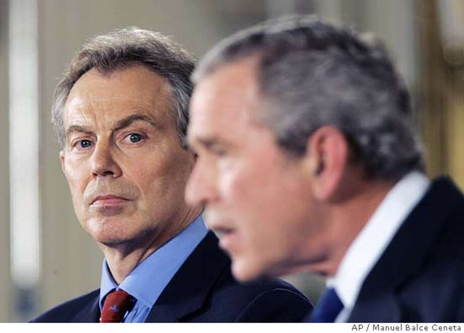 George W Bush, Tony Blair Photo: MANUEL BALCE CENETA