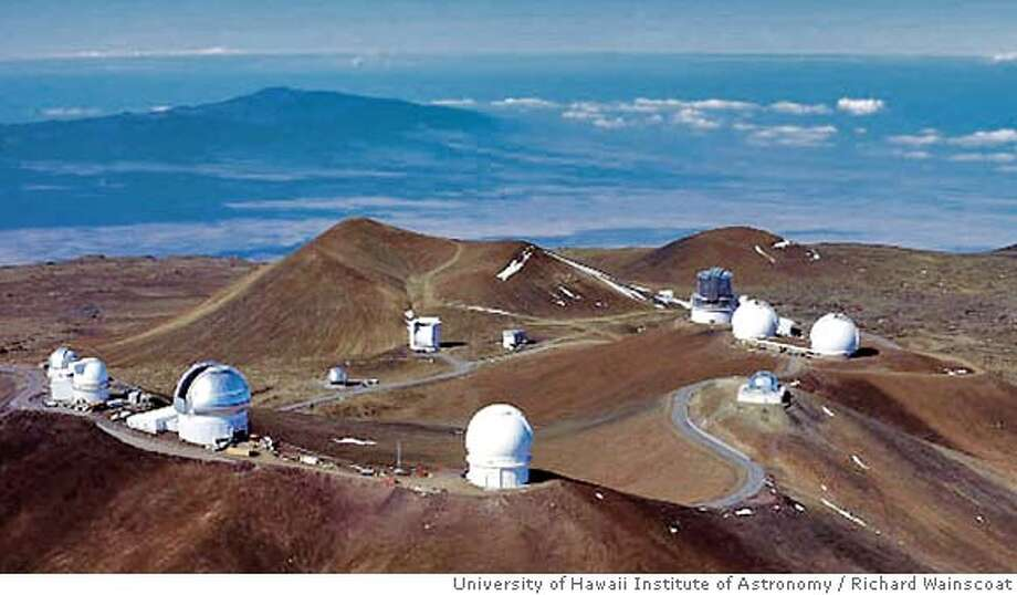 TRAVEL ** ADVANCE FOR SUNDAY JUNE 12 FILE ** This photo released by the University of Hawaii Institute of Astronomy shows an overview of the Mauna Kea mountain summit in February 1998 in Hawaii. The Subaru Telescope, third structure (dark colored) from top right, perched atop this summit of the world's highest island mountain, is one of science's most awesome achievements. Mauna Kea's height, at nearly 14,000 feet, and remote location make it among the finest peaks for land-based astronomy. (AP Photo/University of Hawaii Institute of Astronomy, Richard Wainscoat, File) Photo: RICHARD WAINSCOAT