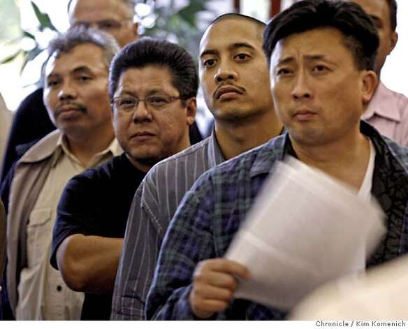 Front to back; Don Hom, Wilmar Tretasco, Ivan Chavez and Jose Santos, all of Hercules, watch on TV monitor in the Hercules City Hall lobby on May 23 as the Hercules City Council debates using eminent domain to halt the construction of a planned WalMart Store there. Kim Komenich / The Chronicle  **Themselves Photo: Kim Komenich