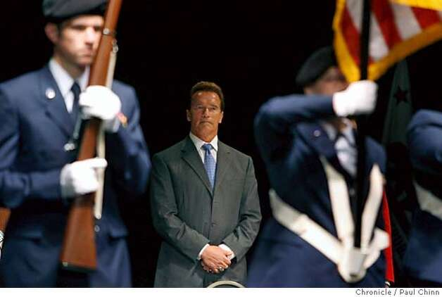 Gov. Arnold Schwarzenegger watches a color guard march off the stage at the end of a swearing-in ceremony for naturalized citizens at the Masonic Auditorium in San Francisco, Calif. on Tuesday, May 23, 2006. PAUL CHINN/The Chronicle  **Gov. Arnold Schwarzenegger MANDATORY CREDIT FOR PHOTOGRAPHER AND S.F. CHRONICLE/ - MAGS OUT Photo: PAUL CHINN
