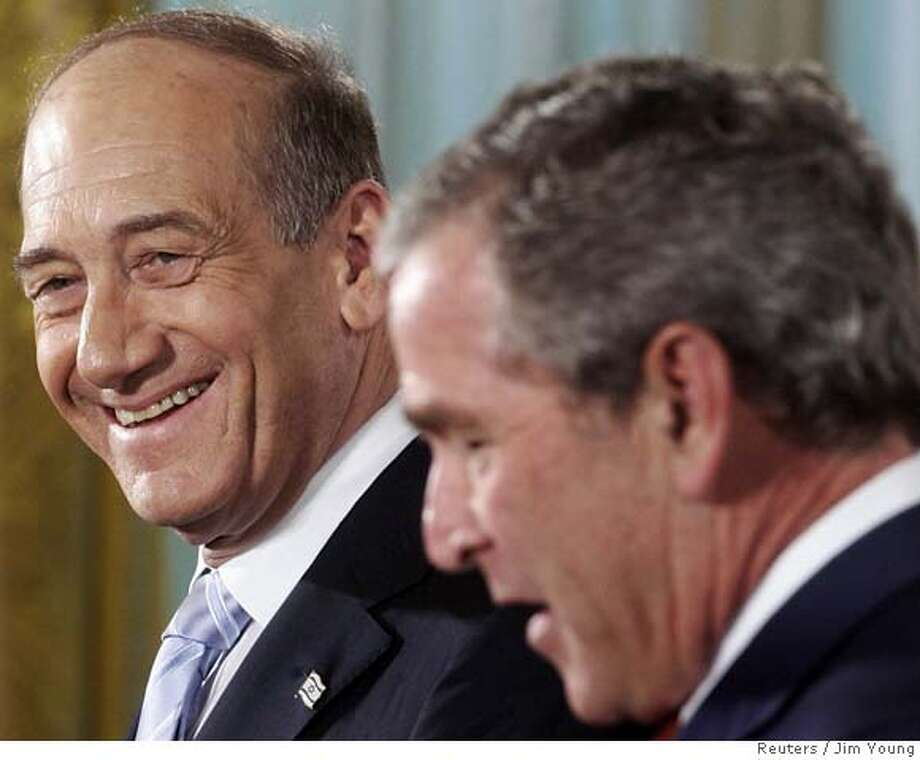 US President Bush laughs with Prime Minister of Israel Olmert during their joint news conference at the White House in Washington Photo: JIM YOUNG