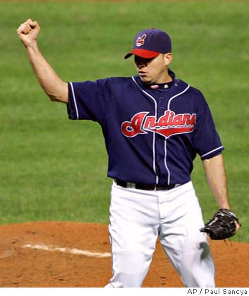 Cleveland Indians pitcher Rafael Betancourt celebrates after Boston Red Sox's Coco Crisp lined out to first for the final out in the Indians 7-3 win in Game 4 of the American League Championship baseball series Tuesday, Oct. 16, 2007, in Cleveland. (AP Photo/Paul Sancya) EFE OUT