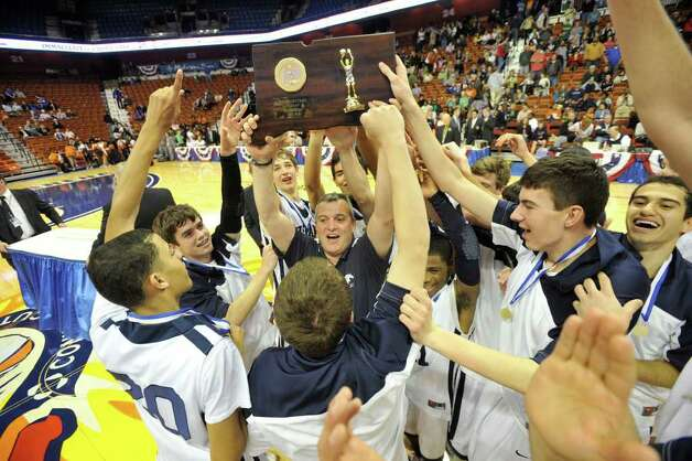 The Immaculate Mustangs celebrate their 67-53 Class S state championship win over Capital Prep at Mohegan Sun Arena in Uncasville on Saturday, March 17, 2012. Photo: Jason Rearick / The News-Times