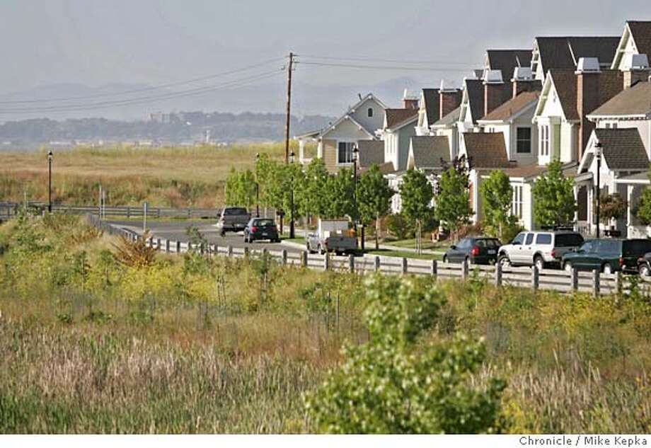 hercules_walmart096_mk.JPG Hercules residents are opposed to the new Wal-Mart planned for this spot (upper left center of frame) near the edge of town. Wednesday May, 17, 2006.  Mike Kepka / THe Chronicle MANDATORY CREDIT FOR PHOTOG AND SF CHRONICLE/ -MAGS OUT Photo: Mike Kepka