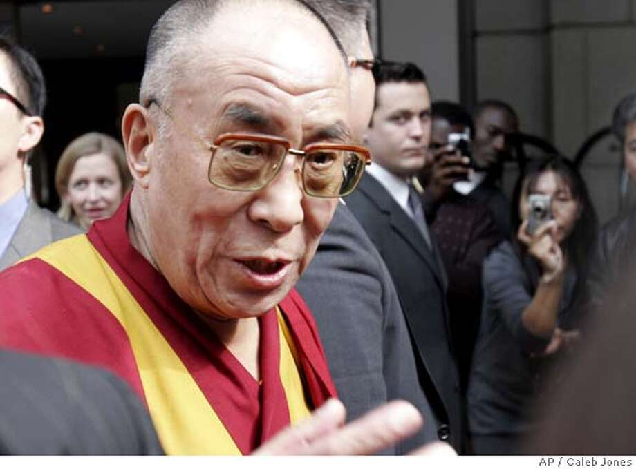 The Dalai Lama speaks with reporters outside his hotel after a visit to the White House and meeting with President Bush, Tuesday, Oct. 16, 2007, in Washington. (AP Photo/Caleb Jones) Photo: Caleb Jones