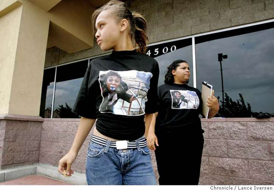 """NADAWN21_037.JPG  Andrea Redmond-Jones age 14 and Brihanna Brewer age 16 are members of Friends of Nadawn """"Nay Nay"""" Brown, showing their support by wearing T-shirts with Brown's photo as they stand outside a Antioch supermarket circulating a petition demanding the Contra Costa District Attorney not accept a plea bargain and to send the Oakley girl's killer to trial.Nadawn """"Nay Nay"""" Brown was an Antioch Deer Valley High School student that was blood gent to death by a classmate after she spurned his advances in her Oakley home earlier this year. 5/20/06 in ANTIOCH.LANCE IVERSEN/SAN FRANCISCO CHRONICLE Ran on: 05-21-2006  Nadawn's Army members Andrea Redmond-Jones and Brihanna Brewer circulate the petition, wearing T-shirts with their friend's photo. Photo: LANCE IVERSEN"""