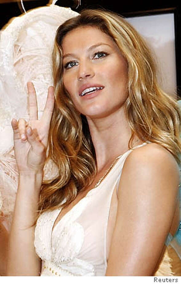 Victoria's Secret model Gisele Bundchen poses during an appearance at the Victoria's Secret store in New York