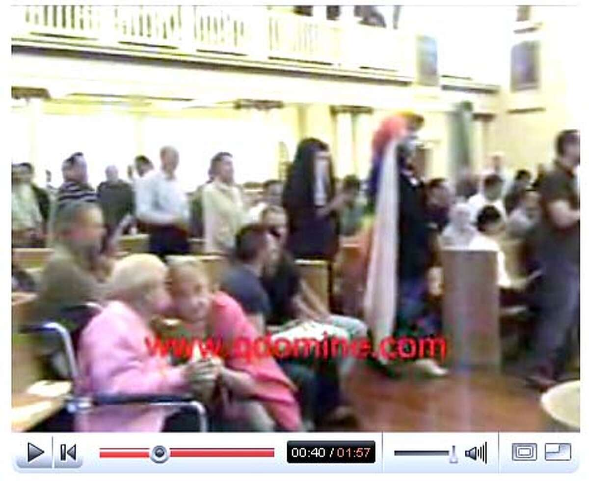 archbishop17_ph7.JPG Screen grab from a youtube video showing members of the Sisters of Perpetual Indulgence attending communion at the Most Holy Redeemer Church in the Castro. The sisters were given communion by Catholic Archbishop George Niederauer which has caused a stir amongst Catholics and conservative talk show host Bill Reilly. www.youtube.com / Courtesy to The Chronicle MANDATORY CREDIT FOR PHOTOG AND SAN FRANCISCO CHRONICLE/NO SALES-MAGS OUT