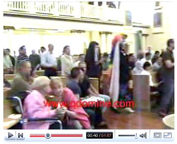 archbishop17_ph7.JPG Screen grab from a youtube video showing members of the Sisters of Perpetual Indulgence attending communion at the Most Holy Redeemer Church in the Castro. The sisters were given communion by Catholic Archbishop George Niederauer which has caused a stir amongst Catholics and conservative talk show host Bill Reilly. www.youtube.com / Courtesy to The Chronicle MANDATORY CREDIT FOR PHOTOG AND SAN FRANCISCO CHRONICLE/NO SALES-MAGS OUT Photo: Www.youtube.com