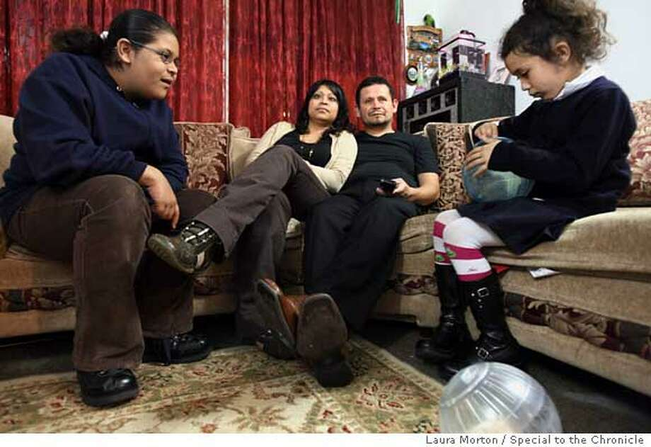 LIVING17_0139_LKM.jpg Stephanie Frias, age 10, and her 6-year-old sister Andrea Frias (right) play with their hamsters while their parents Maria and Ricardo Frias watch television on Tuesday night in their San Francisco home. (Laura Morton/Special to the Chronicle) *** Stephanie Frias  *** Andrea Frias  *** Maria Frias  *** Ricardo Frias Ran on: 10-17-2007  Stephanie Frias, 10, and her 6-year-old sister, Andrea Frias, play with their hamsters while their parents, Maria and Ricardo Frias, watch television in their Excelsior district home in San Francisco.  Ran on: 10-17-2007  Stephanie Frias, 10, and her 6-year-old sister, Andrea Frias, play with their hamsters while their parents, Maria and Ricardo Frias, watch television in their Excelsior district home in San Francisco. Photo: Laura Morton