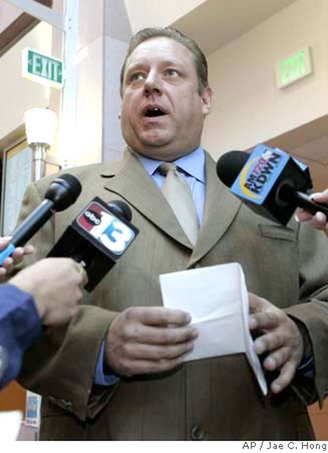 Charles Cashmore, a co-defendant in the O.J. Simpson armed robbery case, speaks to reporters at the Clark County Regional Justice Center in Las Vegas, Monday, Oct. 15, 2007, after he told a judge he would plead guilty to to an alleged armed robbery charge and testify against Simpson and four others in the hotel room theft of sports collectibles from two memorabilia dealers. (AP Photo/Jae C. Hong) Photo: Jae C. Hong