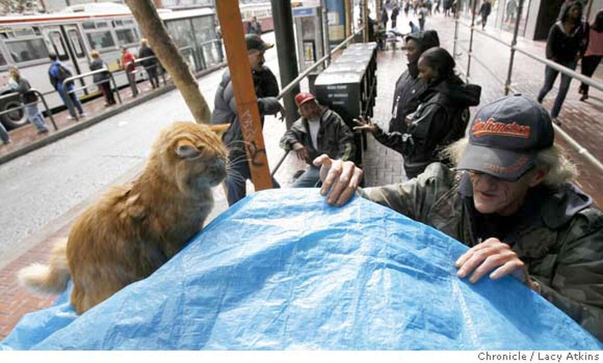 ( right to left) Sam Pike tends to his two cats Wrigley and Jeff as Brenda Winston and Raija Freeman of the homeless outreach talk with Chris Patnode and about finding shelter, Monday Oct. 15, 2007, in San Francisco, CA. Lacy Atkins / The Chronicle Photo taken on 10/15/07, in San Francisco, CA, USA MANDATORY CREDIT FOR PHOTOG AND SAN FRANCISCO CHRONICLE/NO SALES-MAGS OUT