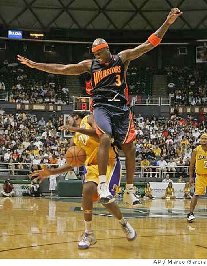 Golden State Warriors forward Al Harrington crashes into Los Angeles Lakers forward Ronny Turiaf during the first quarter of their basketball exhibition game at the Stan Sheriff Center, Tuesday, Oct. 9, 2007 in Honolulu. (AP Photo/Marco Garcia) Photo: Marco Garcia