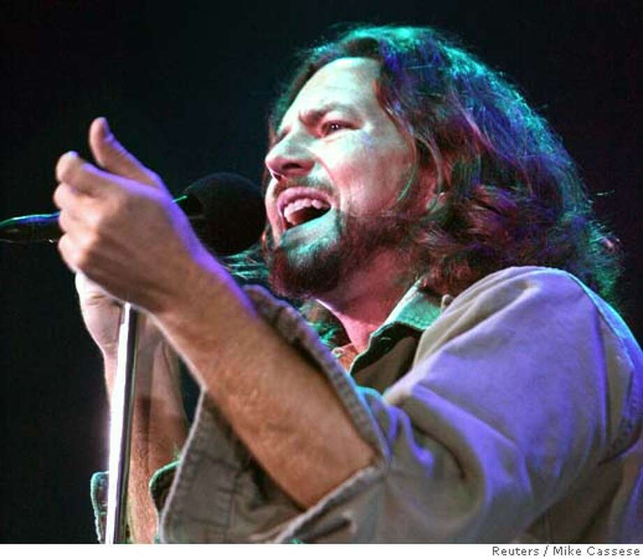 Lead singer Eddie Vedder of the U.S. band 'Pearl Jam' performs at the Air Canada Centre to kick-off the band's latest tour in Toronto, May 9, 2006. Pearl Jam is touring to support their latest release titled 'Pearl Jam' which hit the stores May 2. REUTERS/Mike Cassese 0 Photo: MIKE CASSESE