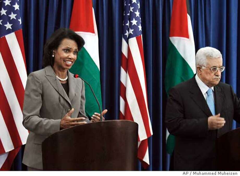 Palestinian President Mahmoud Abbas, right, and U.S. Secretary of State Condoleezza Rice, left, gesture during a joint media conference at Abbas' headquarters in the West Bank city of Ramallah, Monday, Oct. 15, 2007. In an effort to salvage a Middle East peace conference planned for next month, Secretary of State Condoleezza Rice hoped to find some common ground during a meeting Monday with Abbas. (AP Photo/Muhammed Muheisen) Photo: MUHAMMED MUHEISEN