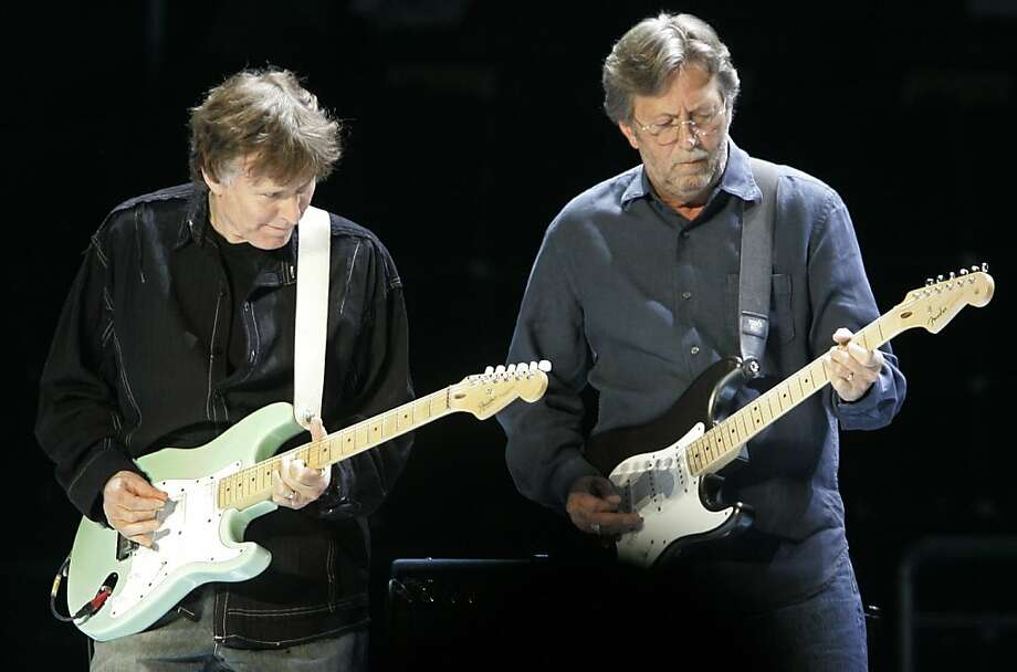 Steve Winwood (left) and Eric Clapton play Fender guitars in New York's Madison Square Garden. Photo: Richard Drew, Associated Press