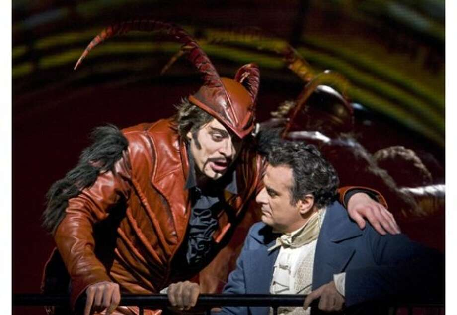 John Relyea (left) as Mephistopheles and Marcello Giordani as Faust in Berlioz's La Damnation de Faust. at the Metropolitan Opera in New York City Ken Howard, Metropolitan Opera Photo: Ken Howard, Metropolitan Opera