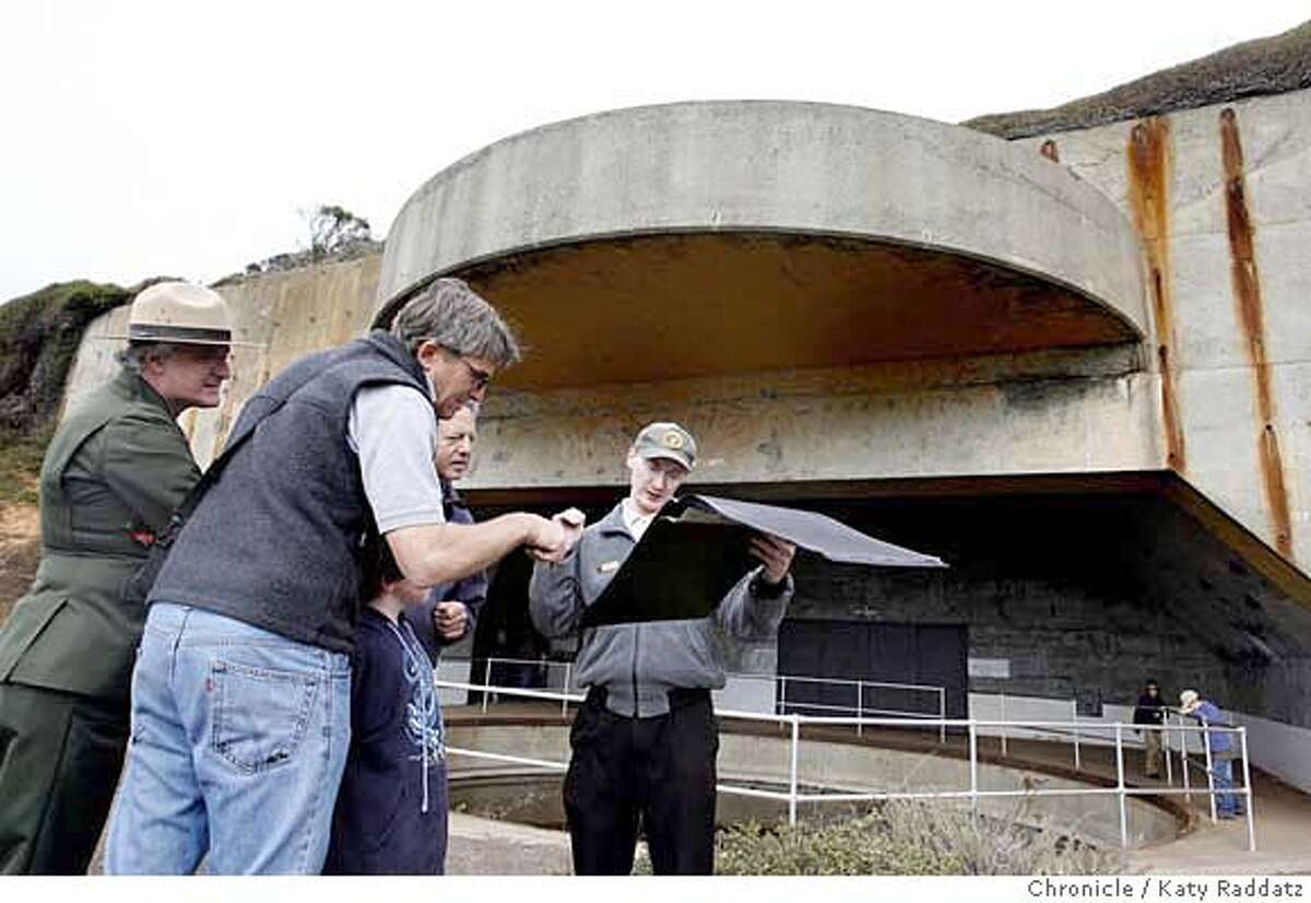 FORT Volunteer guide John Collier shows historic photos of Battery Townsley to an interested group of visitors. The Park Service opens Battery Townsley to the public. Battery Townsley is a gun emplacement built to protect the Golden Gate during WWII. The guns are gone, but the fort is rehabbed and open twice a month. These pictures were made on Sunday, Oct. 14, 2007, in the Marin Headlands, CA. KATY RADDATZ The Chronicle Photo taken on 10/14/07, in Marin Headlands, CA, USA MANDATORY CREDIT FOR PHOTOG AND SAN FRANCISCO CHRONICLE/NO SALES-MAGS OUT
