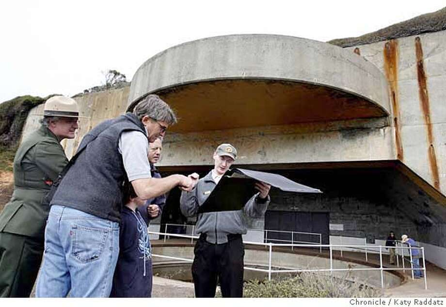 FORT  Volunteer guide John Collier shows historic photos of Battery Townsley to an interested group of visitors. The Park Service opens Battery Townsley to the public. Battery Townsley is a gun emplacement built to protect the Golden Gate during WWII. The guns are gone, but the fort is rehabbed and open twice a month. These pictures were made on Sunday, Oct. 14, 2007, in the Marin Headlands, CA.  KATY RADDATZ The Chronicle  Photo taken on 10/14/07, in Marin Headlands, CA, USA MANDATORY CREDIT FOR PHOTOG AND SAN FRANCISCO CHRONICLE/NO SALES-MAGS OUT Photo: KATY RADDATZ