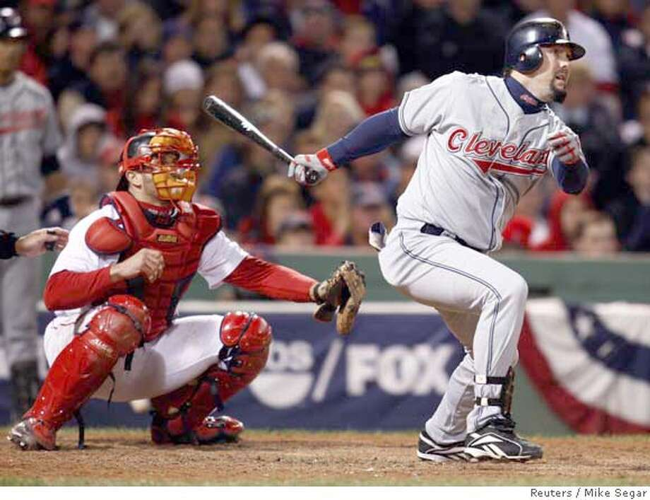 Cleveland Indians' Trot Nixon (R) hits an RBI single in front of Boston Red Sox catcher Jason Varitek during the 11th inning in Game 2 of Major League Baseball's ALCS playoff series in Boston October 13, 2007. REUTERS/Mike Segar (UNITED STATES) 0 Photo: MIKE SEGAR
