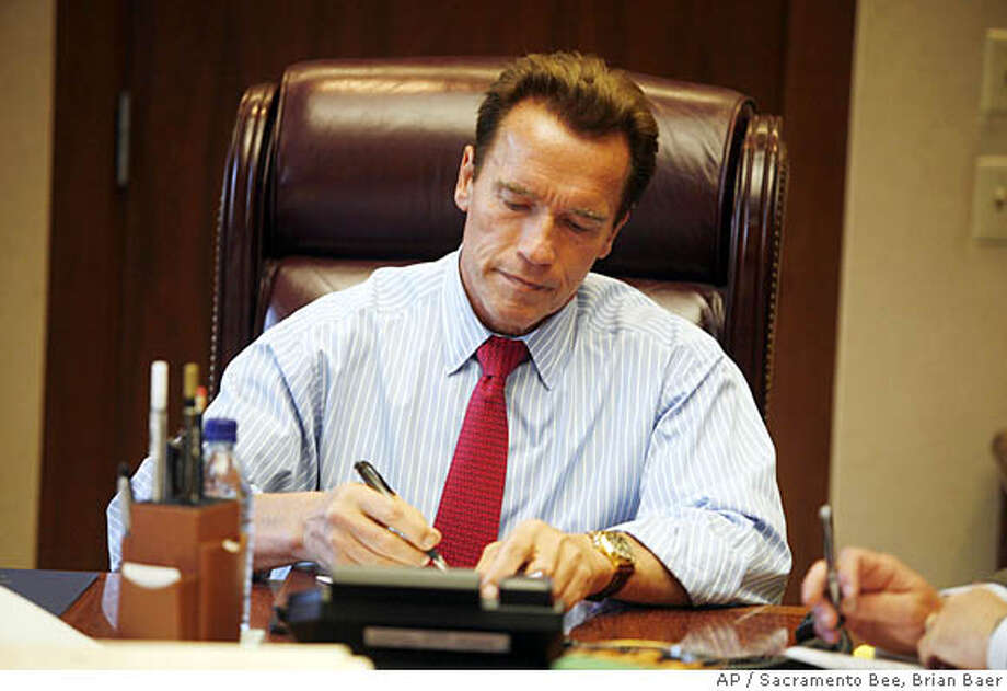 California Gov. Arnold Schwarzenegger signs new bills into law in the Ronald Reagan Cabinet room, Monday Oct. 8, 2007, in Sacramento, Calif. (AP Photo/Sacramento Bee, Brian Baer) ** NO MAGS, NO SALES, NO TV, NO INTERNET ** Photo: Brian Baer