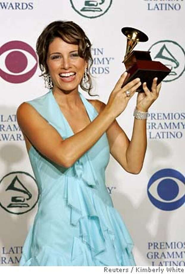 """Colombian-born singer Soraya poses for photographers with her award for Best Singer Songwriter Album for """"Soraya"""" at the 5th annual Latin Grammy Awards in Los Angeles in this September 1, 2004 file photo. Soraya died in a Miami-area hospital on May 10, 2006 after a long battle with breast cancer, her manager said. REUTERS/Kimberly White/Files 0 Photo: KIMBERLY WHITE"""