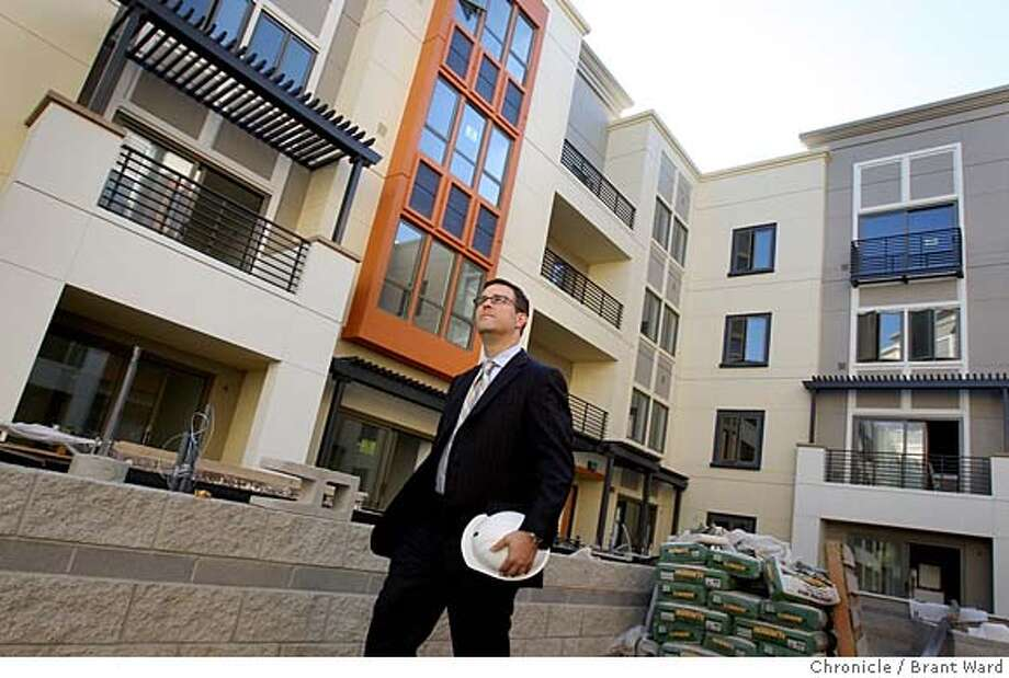 UPTOWN_211.JPG  Signature Properties Mike Ghielmetti (chk spell) takes a walk through the courtyard of his Broadway Grand development.  Jerry Brown's dream of 10,000 new Oakland residents is embodied in the Uptown District of Oakland, bounded by 18th to 22nd streets and Broadway and Telegraph Avenues.  Construction is roaring along on some of the most ambitious condo-retail projects. {By Brant Ward/San Francisco Chronicle}9/18/07 Photo: Brant Ward