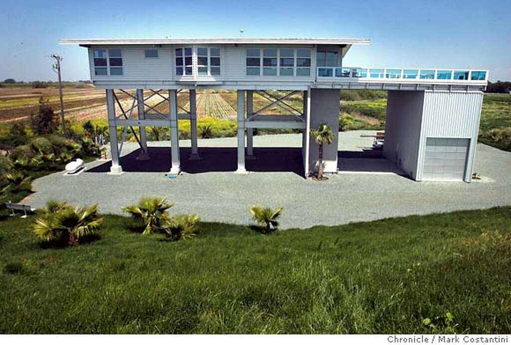 Plans likewise beach cabin pilings stilts house further for Island house plans on pilings