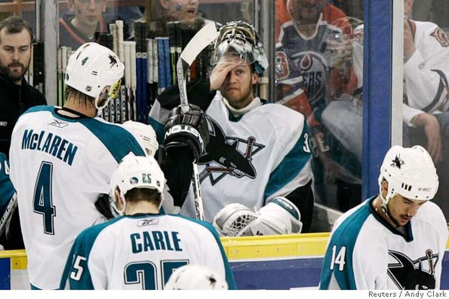 San Jose Sharks Vesa Toskala sits on bench after he was benched during NHL playoff against Edmonton Photo: ANDY CLARK