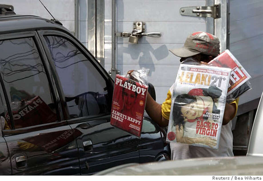 A street vendor displays the first edition of the Indonesian version of Playboy magazine in Jakarta April 21, 2006. Indonesian Playboy's publishers are weighing whether to print again after violent protests over the first issue, now being offered on eBay as a collector's item. REUTERS/Beawiharta 0 Photo: BEAWIHARTA