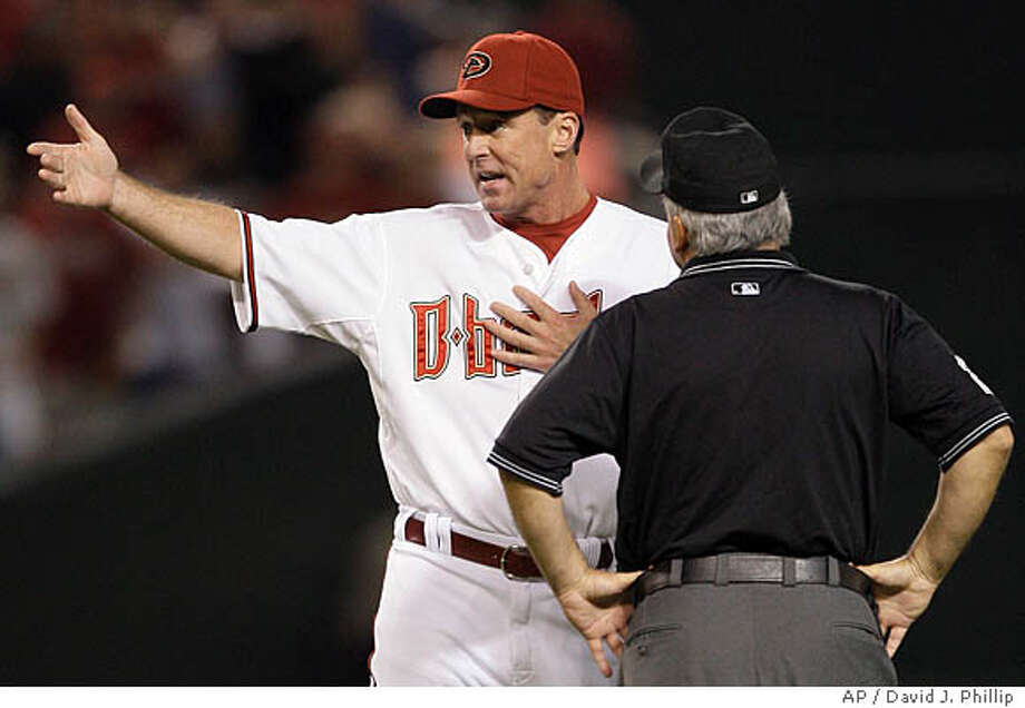 Arizona Diamondbacks manager Bob Melvin argues and interference call with umpire Larry Vanover during the seventh inning in Game 1 of the National League Championship baseball series in Phoenix, Thursday, Oct. 11, 2007. (AP Photo/David J. Phillip) Photo: David J. Phillip