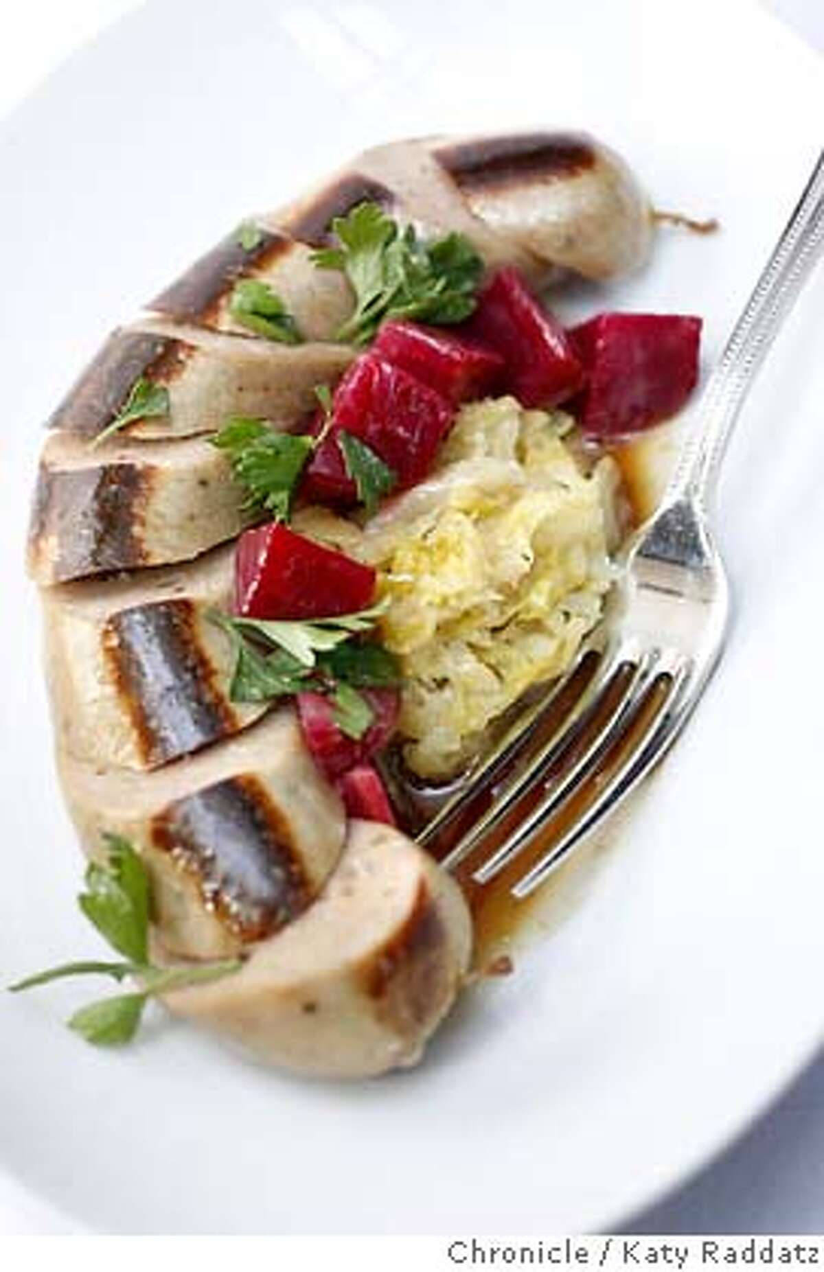 d.14SPRUCE_035_RAD.jpg SHOWN: Boudin Blanc with house made sauerkraut and beets from the restaurant's farm. Spruce is an important restaurant that has just opened in San Francisco at 3640 Sacramento St. (Katy Raddatz/The Chronicle) **