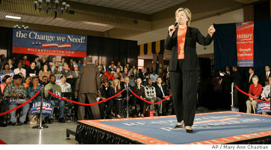 Presidential hopeful Sen. Hillary Rodham Clinton, D-N.Y., hosts a town-hall style meeting at Wilson Senior High School Saturday, Oct. 13, 2007, in Florence, S.C. (AP Photo/Mary Ann Chastian) Photo: Mary Ann Chastain