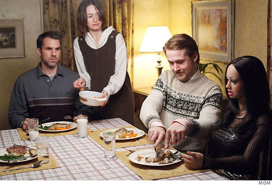 "Paul Schneider, Emily Mortimer, Ryan Gosling and ""Bianca"" the doll in ""Lars and the Real Girl Photo: MGM"