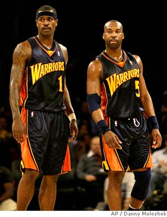 Golden State Warriors' Stephen Jackson, left, and Baron Davis stand on the court together during the first half of an NBA basketball game against the Los Angeles Lakers on Monday, Jan. 22, 2007, in Los Angeles. It was the first game that Jackson and Davis played together since Jackson came to the Warriors in a trade last week. (AP Photo/Danny Moloshok)  Ran on: 01-23-2007  New Warrior Al Harrington made up for a lackluster game Saturday night with a 30-point performance.  Ran on: 01-23-2007  New Warrior Al Harrington made up for a lackluster game Saturday night with a 30-point performance. EFE OUT Photo: Danny Moloshok