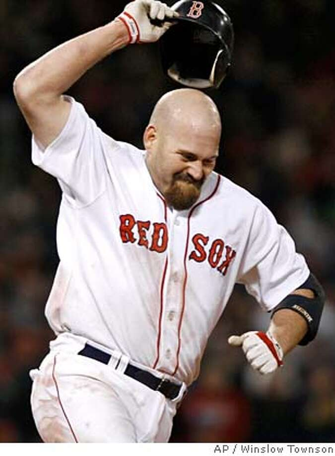 Boston Red Sox's Kevin Youkilis reacts after his line drive was caught by Cleveland Indians center fielder Grady Sizemore to end the Red Sox's scoring threat in the bottom of the ninth inning in Game 2 of the American League Championship baseball series Sunday, Oct. 14, 2007, at Fenway Park in Boston. (AP Photo/Winslow Townson) Photo: Winslow Townson