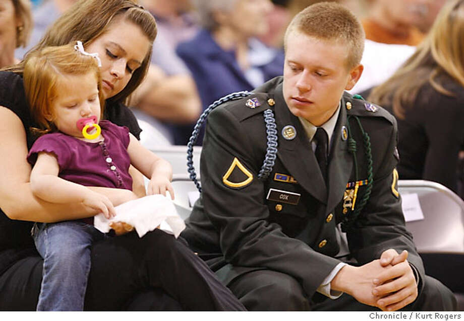 Kory Cox (right) his wife Haley 21 and their daughter Jessica Kory was with Nicholas when he died.  Nicholas P. Olson Soldier from Novato a former Novato High student killed in Iraq by a suicide bomber services were being healed at Novato High School .  GIFUNERAL14_0086_KR.jpg  Kurt Rogers / The Chronicle Photo taken on 10/13/07, in San Francisco, CA, USA Photo: Kurt Rogers