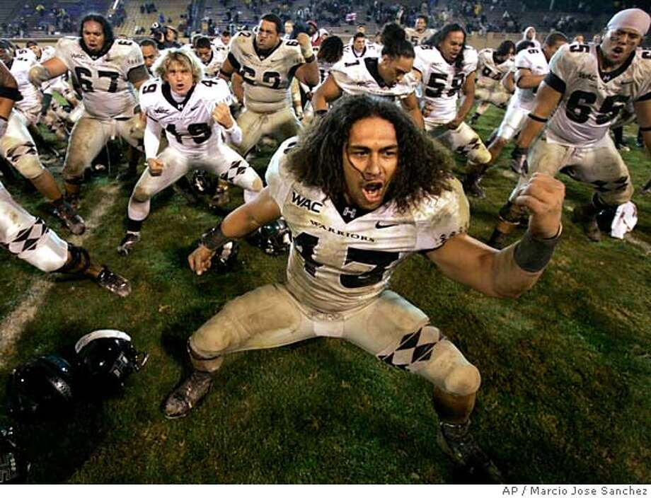 Hawaii players celebrate a win over San Jose State in a college football game in San Jose, Calif., Friday, Oct. 12, 2007. Hawaii won, in overtime, 42-35. (AP Photo/Marcio Jose Sanchez) EDS. NOTE: IMAGE TAKEN WITH WIDE ANGLE LENS Photo: Marcio Jose Sanchez
