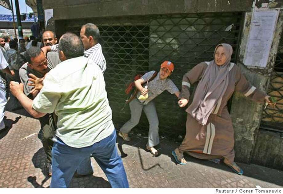 Egyptian plainclothes police clash with protesters during a protest in Cairo May 11, 2006. Egyptian security forces beat activists and assaulted and detained journalists on Thursday during a protest in support of judges who faced a disciplinary committee for criticising election abuses last year. REUTERS/Goran Tomasevic  Ran on: 05-12-2006  Plainclothes police clash with protesters during a protest in Cairo. Egyptian security forces beat activists and assaulted journalists. Photo: GORAN TOMASEVIC