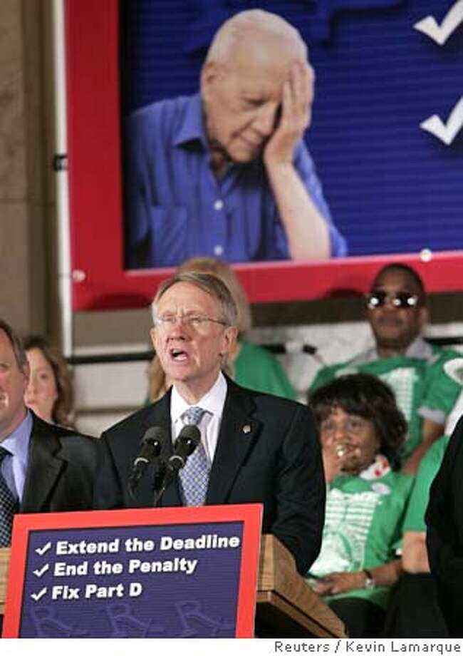 Senate minority leader Harry Reid speaks to the elderly at a medicare rally in Washington Photo: KEVIN LAMARQUE