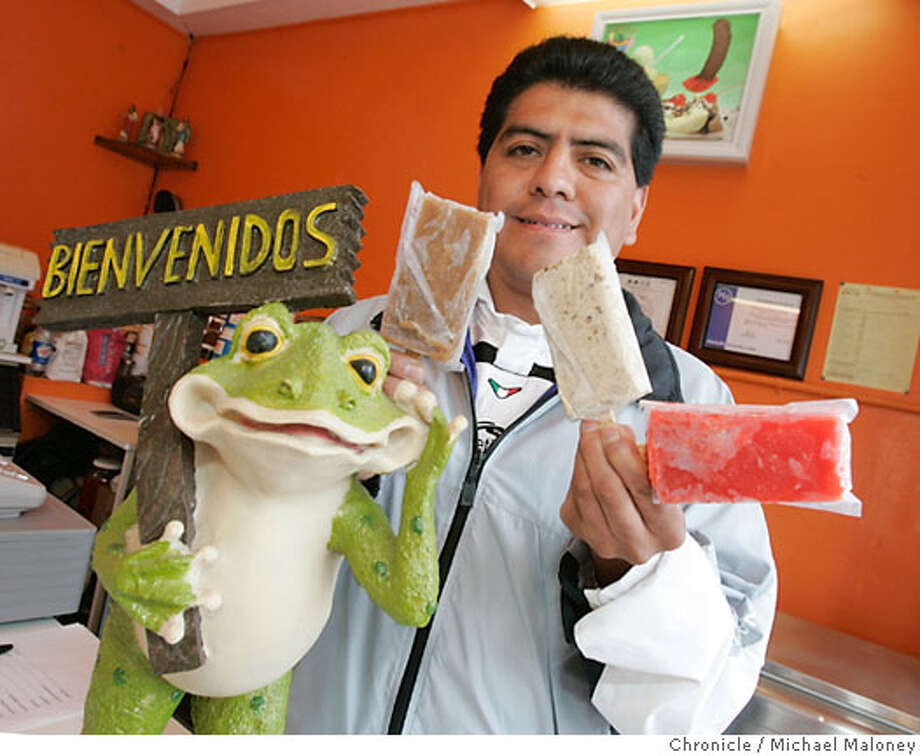 SETREETDATE11_046_MJM.jpg  Eats on Grand Ave in South SF  Guillermo Morales with his flavored paletas.  The Puddle of the Frogs Ice Cream. 250 Grand Ave. After years making paletas (popsicles made from fresh, seasonal fruits) in his native Mexico, Guillermo Morales decided to try his luck in the U.S. Unlike paletas often sold by street vendors stateside, Morales uses no artificial ingredients in his kiwi, pineapple, strawberry and other flavored paletas. Photo by Michael Maloney / San Francisco Chronicle on 5/5/06 in South San Francisco,CA Photo: Michael Maloney