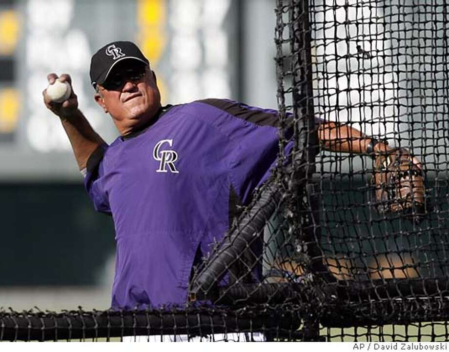 Colorado Rockies manager Clint Hurdle throws batting practice before the Rockies faced the Pittsburgh Pirates in a baseball game in Denver on Aug. 20, 2007. Hurdle and his team are headed to the National League Championship Series against the Arizona Diamondbacks. (AP Photo/David Zalubowski) PHOTO TAKEN AUG. 20, 2007 Photo: David Zalubowski