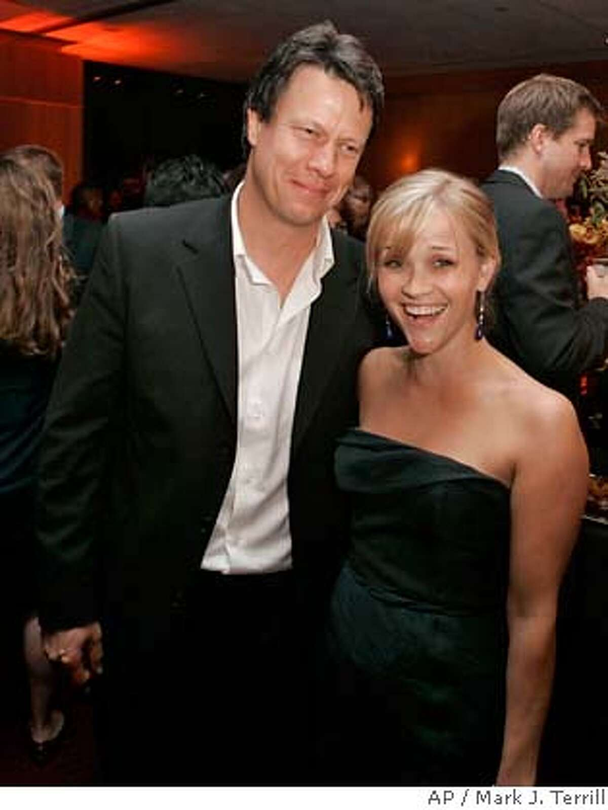 """Gavin Hood, left, and Reese Witherspoon are seen during an after-party for the premiere of """"Rendition"""" in Beverly Hills, Calif., Wednesday, Oct. 10, 2007. (AP Photo/Mark J. Terrill)"""