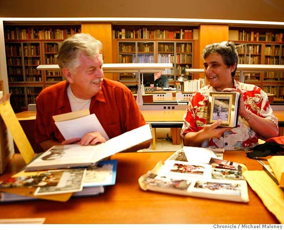Lorraine Grassano (right) shares a photo with Bob Locke as they look over their family photos at the San Francisco Library.  The San Francisco Library wants to expand its photo archive of the city's gay history and is asking people to bring their photo albums. The library is looking for daily life, work and family shots, to balance out the over - documented gay pride parade and castro halloween, etc. events. Three people who plan to donate photos show us their albums: Sister Kitty Catalyst, Bob Locke (brother of a famous porn star) and Lorraine Grassano. Photo by Michael Maloney / San Francisco Chronicle  ***Sister Kitty Catalyst, Bob Locke, Lorraine Grassano MANDATORY CREDIT FOR PHOTOG AND SF CHRONICLE/NO SALES-MAGS OUT Photo: Michael Maloney
