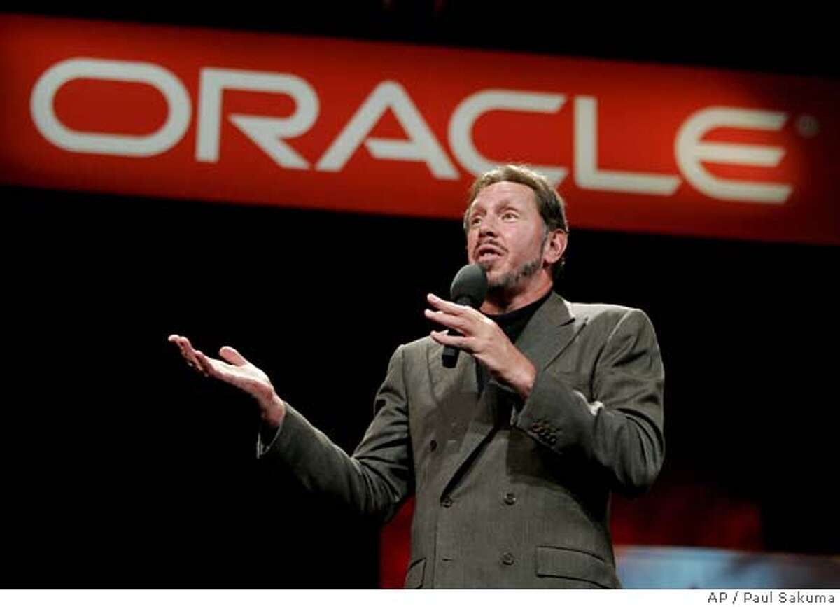 **FILE**Oracle Corp. chief executive Larry Ellison gestures at his keynote address at Oracle Open World Conference in a San Francisco file photo from Sept. 21, 2005. Business software maker Oracle Corp. will buy Hyperion Solutions Corp. for $3.3 billion in cash, renewing a shopping spree aimed at toppling rival SAP AG. The deal announced Thursday, March 1, 2007 will give Oracle control of Hyperion technology that help companies track their business performance _ tools that are widely used by many of SAP's customers.(AP Photo/Paul Sakuma, File) Ran on: 03-09-2007 Buffett SEPT. 21, 2005 FILE PHOTO