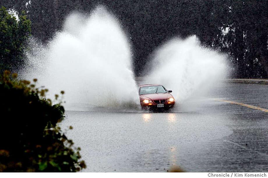 A motorist drives through standing water on Lake Merced Blvd. near Berkshire Friday afternoon.  Photo by Kim Komenich/The Chronicle  ** Photo: Kim Komenich