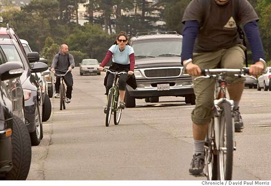 SAN FRANCISCO,- APRIL 29: Bicyclists make their way between the cars along JFK drive in Golden Gate Park on April 29, 2006 in San Francisco, California. (Photo by David Paul Morris/The Chronicle) Photo: David Paul Morris