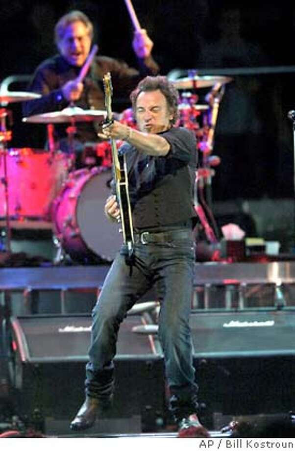 Bruce Springsteen and Max Weinberg, rear, perform with the E Street Band Tuesday night, Oct. 9, 2007 at Continental Airlines Arena in East Rutherford, N.J. (AP Photo/Bill Kostroun) Photo: Bill Kostroun